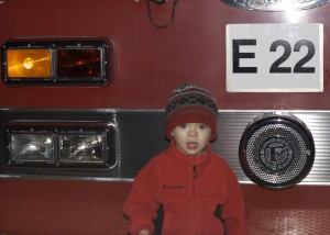 Richardson sets up Santa's Village by the civic center. We went on a freezing cold night.  Brenden's favorite part was this fire truck in the parking lot that all the kids were climbing on. Oh, and the cookie Mrs. Claus gave him!