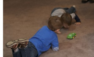 Noah and Brenden were happy to have each other as playmates and enjoyed playing with cars together.