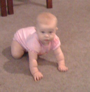 Emily is so close to crawling. I'm not sure how she's doing it, but she's getting places.