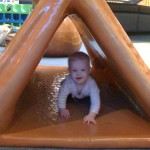 Having fun at a mall play area.